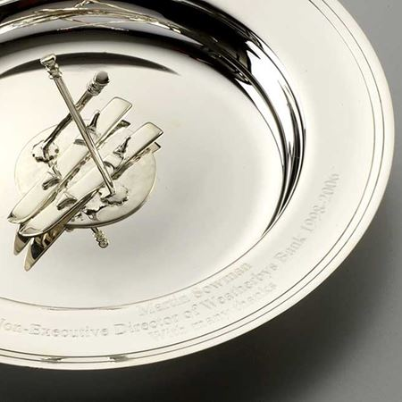 silver dish with skis